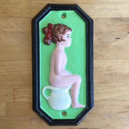 Cast iron boy & girl toilet sign